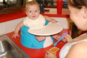 Finn - 6 months old.  Loving the Sweet Potato Puree.