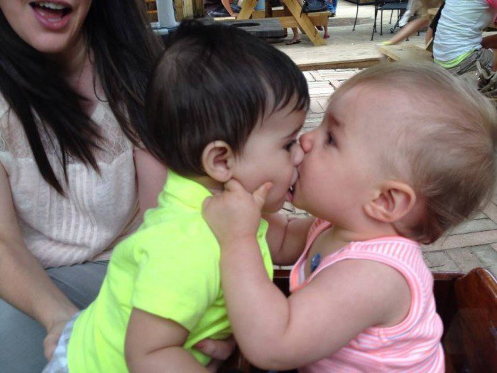Two babies kissing