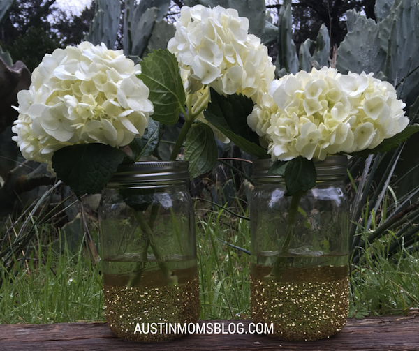 Glitter Mason Jars  What You Need:  Mason Jars Painters Tape Mod Podge Glue Paint Sponge GLITTER What You Do:  Wrap Painters tape around the lower section of your mason jar. Generously apply the mod podge with your paint sponge below the tape Sprinkle all over with glitter and wait for it to dry. Peel the tape off and garnish with some gorgeous SPRING flowers!