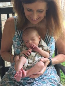 Grandma holds first grandchild