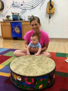 mother and baby playing drum at music class