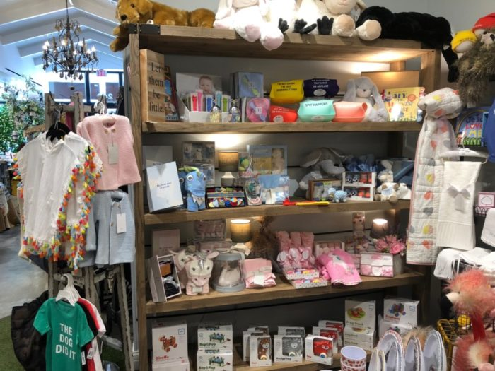 baby items in interior of Lizzy Lu gift shop