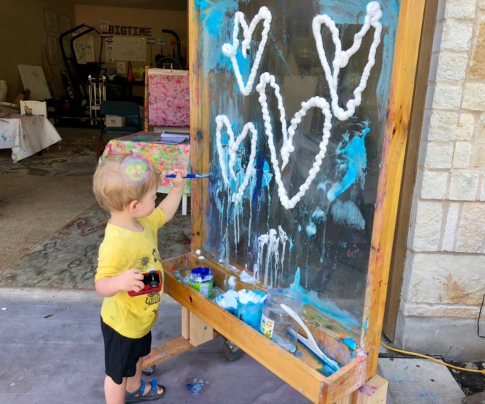 little boy painting at KK's Art Club in Austin, Texas