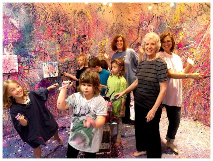 children and parents painting