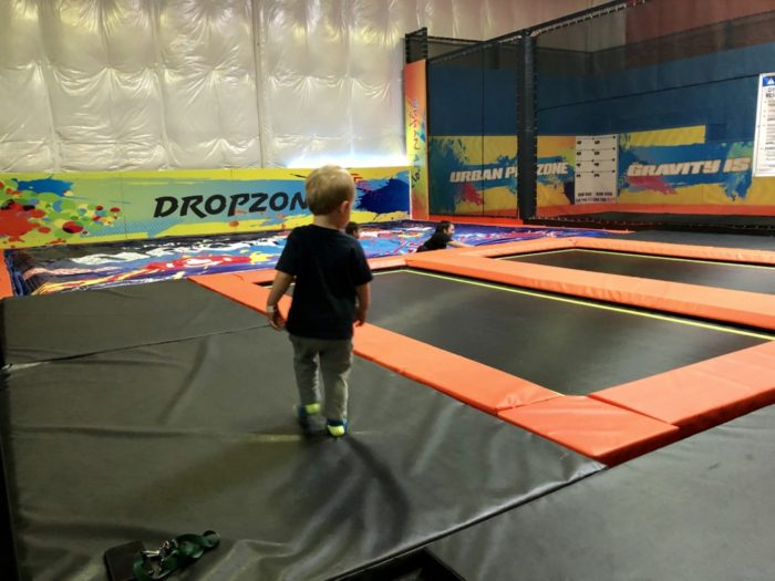 child jumping on trampoline at urban air adventure park