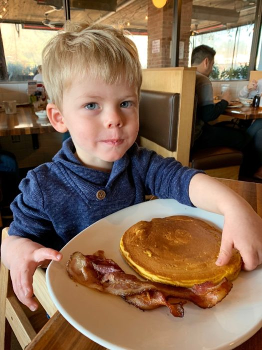 child eating pancakes and bacon at Kerbey Lane restaurant in Austin, Texas