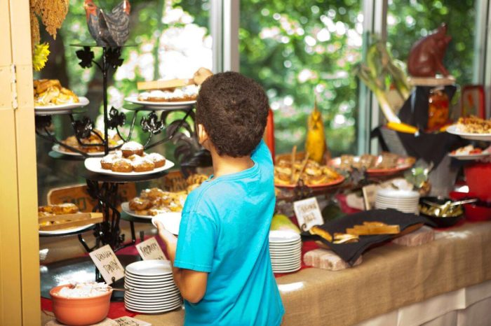 child getting food from the buffet at Jack Allen's restaurant in Austin, Texas