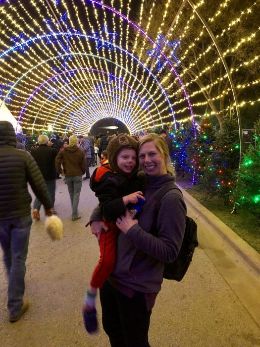 mother holding young son at the Austin Trail of Lights in Austin, Texas