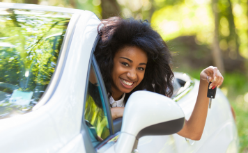 black girl learning driver safety - defensive driving