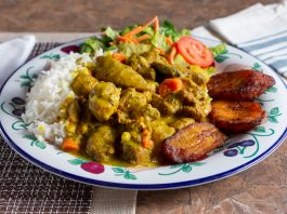 A view of a Caribbean dish of curry chicken in a restaurant or kitchen setting